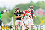 Shane McSweeney Kilcummin gets past Ciaran Kelleher Milltown during their County Championship clash in Kilcummin On Saturday