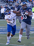 Nevada running back Blake Wright (33) straight-arms San Jose State's saftey Maurice McKnight (10) in the second half of an NCAA college football game in Reno, Nev. Saturday, Nov. 11, 2017. (AP Photo/Tom R. Smedes)