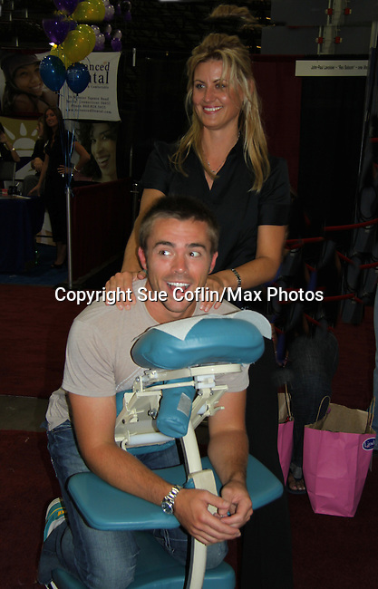 One Life To Live John-Paul Lavoisier gets a massage by Katalin Walinski at the 8th Annual Connecticut Women's Expo presented by Comcast on September 11 & 12, 2010 at the Connecticut Expo Center, Hartford, Connecticut. (Photo by Sue Coflin/Max Photos)