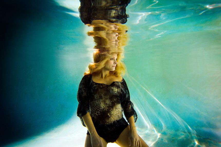 A female underwater fashion model.