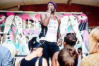 Big Freedia performs during her concert at MOMA's PS 1 venue in Queens, NY, part of the annual &quot;Warm Up&quot; music series on August 28, 2010.  <br /> <br /> Big Freedia, from New Orleans, is a main figure in the &quot;Sissy Bounce&quot; music scene.  &quot;Sissy Bounce&quot; is a subset of &quot;Bounce&quot;, a type of rap music that originated in New Orleans in the early 1990s.  Bounce is distinctive in its quick, highly danceable beat, frequent call and response, and typically sexual lyrics.  &quot;Sissy bounce&quot; is distinctive not in any musical way from &quot;bounce&quot; but in the performers who are homosexual men.