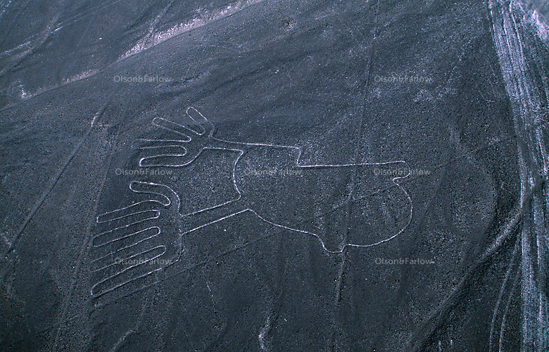 Aerials of the Nazca lines, only visible from the air.  Perfect geometric designs such as triangles and rectangles and straight lines running for several kilometers across the desert.  Some are animal shapes are 90 to 180 meters long. It is believed they were made by the Nazca and Paracas cultures during the period between 900 BC and 600 AD.  Maria Reiche, a German mathematician who spent much of her life studying the lines considers the lines to be an astronomical calendar for agricultural purposes.