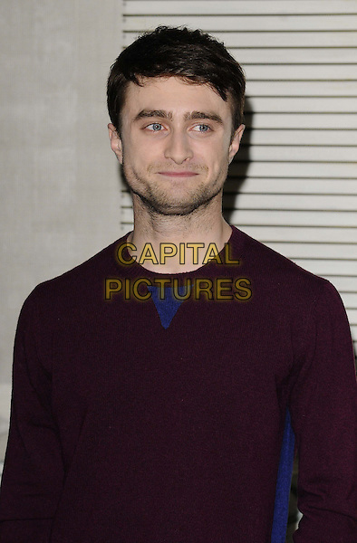 Daniel Radcliffe<br /> The &quot;Kill Your Darlings&quot; film photocall, 57th BFI London Film Festival day 9, Corinthia Hotel, Whitehall Place, London, England.<br /> October 17th, 2013<br /> half length maroon top  stubble facial hair <br /> CAP/CAN<br /> &copy;Can Nguyen/Capital Pictures