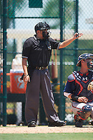 Umpire Josh Gilreath asks field umpire Ben Rosen (not shown) for a calls confirmation during a game between the GCL Braves and GCL Pirates on August 10, 2016 at Pirate City in Bradenton, Florida.  GCL Braves defeated the GCL Pirates 5-1.  (Mike Janes/Four Seam Images)