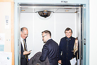 Philippe Douste-Blazy (right), professor Rifat Atun (left) and Robert Filipp (center) ride an elevator during Douste-Blazy's visit to Harvard University's T. H. Chan School of Public Health in Boston, Massachusetts, USA. Filipp is the president of the Innovative Finance Foundation and helped organize Douste-Blazy's visit to Harvard. Atun is the director of the Global Health Systems Cluster and a Professor of Global Health Systems at the School of Public Health. The visit is part of his campaign to become Director General of the World Health Organization. During the visit, he met with professors, students, and visiting scholars, including former Ministers of Health from England and Brazil. Doutse-Blazy is Under-Secretary-General and Special Adviser on Innovative Financing for Development in the United Nations and chairman of UNITAID. He served as Minister of Health, Minister of Culture, and Foreign Minister in the French government and was also mayor of Lourdes and Toulouse.