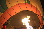 "Hot air balloon fired up at the Napa Valley night glow festival, Napa, CA. ""Night Bloom"" Napa's After Dark Hot Air Balloon Experience 2019 ."