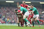 Ireland number 8 Jamie Heaslip stops Wales hooker Scott Baldwin.<br /> RBS 6 Nations<br /> Wales v Ireland<br /> Millennium Stadium<br /> 14.03.15<br /> &copy;Steve Pope - SPORTINGWALES
