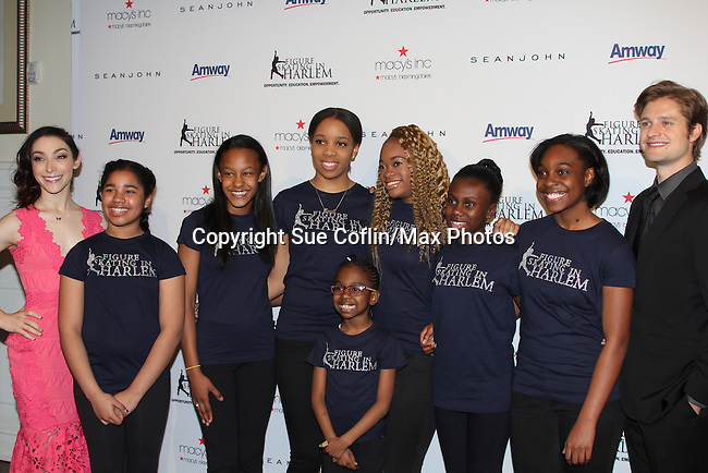Meryl Davis & Charlie White pose with Figure Skating in Harlem Students - The 11th Annual Skating with the Stars Gala - a benefit gala for Figure Skating in Harlem - honoring Meryl Davis & Charlie White (Olympic Ice Dance Champions and Meryl winner on Dancing with the Stars) and presented award by Tamron Hall on April 11, 2016 on Park Avenue in New York City, New York with many Olympic Skaters and Celebrities. (Photo by Sue Coflin/Max Photos)
