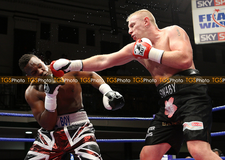 Derek Chisora (Finchley, Union Jack shorts) defeats Lee Swaby (Lincoln, black shorts)  in a Heavyweight boxing contest at York Hall, Bethnal Green, promoted by Frank Warren, Sports Network - 26/09/08 - MANDATORY CREDIT: Gavin Ellis/TGSPHOTO - Self billing applies where appropriate - 0845 094 6026 - contact@tgsphoto.co.uk - NO UNPAID USE.