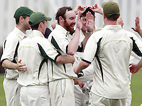 James Baker (C) of North London is mobbed after taking the wicket of Jake Sharland during the Middlesex County Cricket League Division Three game between Highgate and North London at Park Road, Crouch End on Sat July 12, 2014