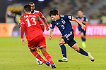 Minamino Takumi of Japan (R) is challenged by Khalid Al Braiki (L) and Saad Al Mukhaini of Oman during the AFC Asian Cup UAE 2019 Group F match between Oman (OMA) and Japan (JPN) at Zayed Sports City Stadium on 13 January 2019 in Abu Dhabi, United Arab Emirates. Photo by Marcio Rodrigo Machado / Power Sport Images