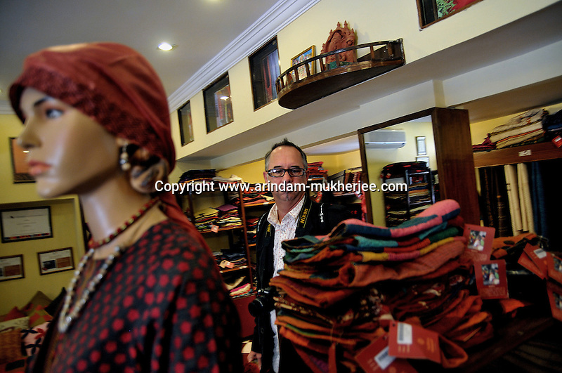 "Mr. Mark Kayen, Director of visual maketing(North America) of Olsen checking garments during his visit to the showroom of ""Sadhna"" in Udaipur, Rajasthan, India. 24.1.2011. Arindam Mukherjee"