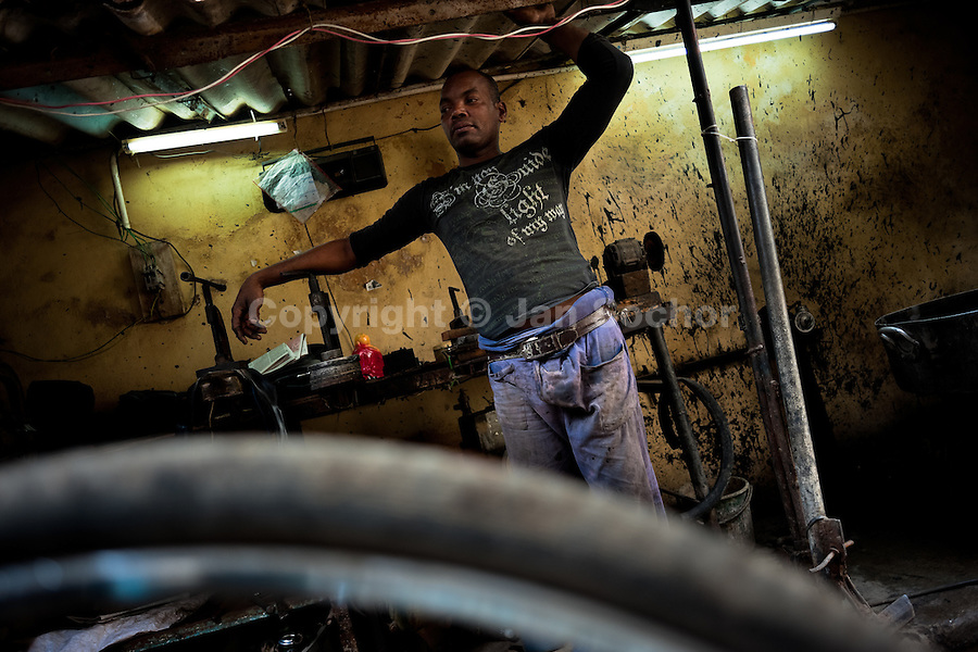 A Cuban service man stands in the bicycle repair shop in Havana, Cuba, 10 February 2011.