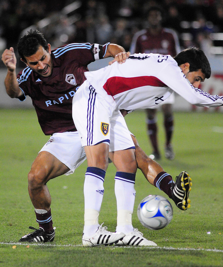 25 October 08: Rapids midfielder Pablo Mastroeni (in red) against Real Salt Lake midfielder Javier Morales (11). Real Salt Lake tied the Colorado Rapids 1-1 at Dick's Sporting Goods Park in Commerce City, Colorado. The tie advanced Real Salt Lake to the playoffs.