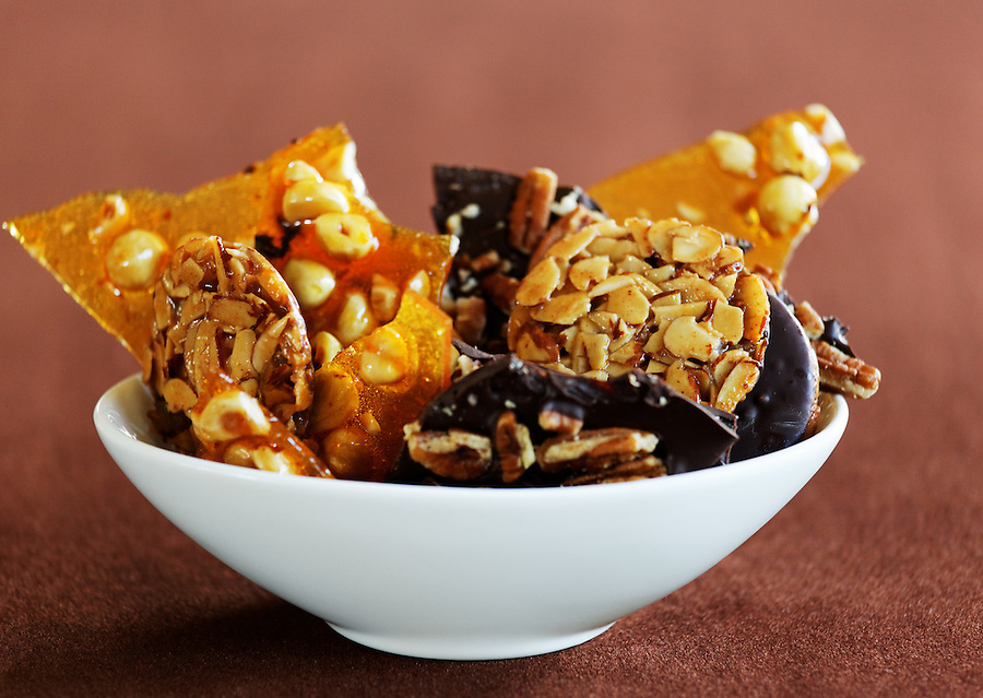 Hazelnut brittle, almond Florentines and chocolate pecan bark in a bowl, by pastry chef Laurie Pfalzer, Pastry Craft