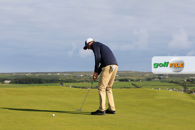 Aaron Moore (Adare Manor) on the 1st green during Round 2 of the South of Ireland Amateur Open Championship at LaHinch Golf Club on Thursday 23rd July 2015.<br /> Picture:  Golffile | Thos Caffrey