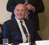 White House Chief of Staff John Kelly listens to President Donald J. Trump make statements on the ongoing investigation of  election meddling and on the current situation in Syria during a meeting with senior military leadership at The White House in Washington, DC, March 9, 2018. <br /> CAP/MPI/RS<br /> &copy;RS/MPI/Capital Pictures