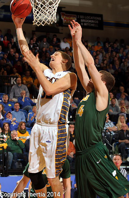 BROOKINGS, SD - JANUARY 25:  Marcus Heemstra #32 from South Dakota State University takes the ball to the basket against Taylor Braun #24 from North Dakota State University in the first half of their game Saturday afternoon at Frost Arena in Brookings. (Photo by Dave Eggen/Inertia)