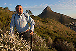 CAPE TOWN, SOUTH AFRICA MAY 23: Hiking expert Mike Lundy poses for a portrait on a path with a view of Lions head mountain on May 23, 2014 in Cape Town, South Africa. The city offers many different hiking trails close to the city center. (Photo by: Per-Anders Pettersson)