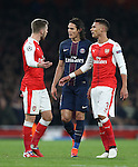 PSG's Edinson Cavani tussles with Arsenal's Aaron Ramsey during the Champions League group A match at the Emirates Stadium, London. Picture date November 23rd, 2016 Pic David Klein/Sportimage