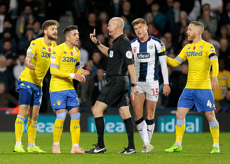 The Leeds United players argue with Referee Lee Mason<br /> <br /> Photographer David Shipman/CameraSport<br /> <br /> The EFL Sky Bet Championship - West Bromwich Albion v Leeds United - Saturday 10th November 2018 - The Hawthorns - West Bromwich<br /> <br /> World Copyright © 2018 CameraSport. All rights reserved. 43 Linden Ave. Countesthorpe. Leicester. England. LE8 5PG - Tel: +44 (0) 116 277 4147 - admin@camerasport.com - www.camerasport.com