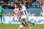 Atletico de Madrid's Oliver Torres (l) and Real Sociedad's Capilla during La Liga match. March 1,2016. (ALTERPHOTOS/Acero)