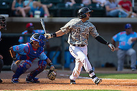 Christian Marrero (24) of the Birmingham Barons follows through on his swing against the Tennessee Smokies at Regions Field on May 3, 2015 in Birmingham, Alabama.  The Smokies defeated the Barons 3-0.  (Brian Westerholt/Four Seam Images)