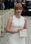 Jessica Chastain receives her present  in front of her dedicated beach locker room on the Promenade des Planches on September 5, 2014 in Deauville, France