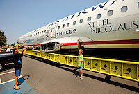 To the delight of cheering onlookers, US Airways Flight 1549, also known as the Miracle on the Hudson plane, traveled in pieces to its final resting place at the Carolina Aviation Museum in Charlotte, NC.  Two years earlier, the commercial passenger flight was enroute to Charlotte/Douglas International Airport when it was successfully landed in New York's Hudson River after striking a flock of Canada Geese six minutes after taking off from LaGuardia Airport.