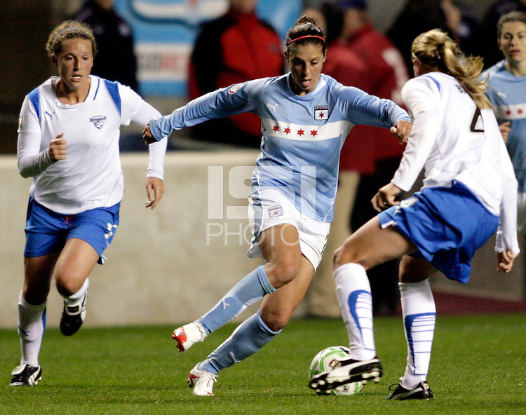 Chicago Red Stars midfielder Carli Lloyd (10) maneuvers between Boston Breakers defender Kasey Moore (17, left) and midfielder Stacy Bishop (4, right).  The Chicago Red Stars defeated the Boston Breakers 4-0 at Toyota Park in Bridgeview, IL on April 25, 2009.