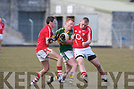 Kerry's Johnny Buckley and Cork's l-r:  J. P. Murphy and Paul Honahan.