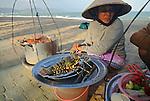 Asia, Vietnam, Nha Trang. Selling and preparing fresh sea food at Nha Trang's beach.