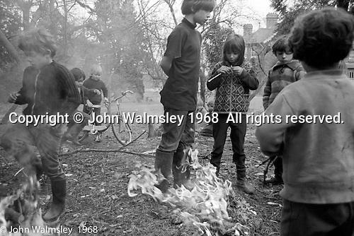 Lighting bonfires in the school grounds, Summerhill school, Leiston, Suffolk, UK. 1968.