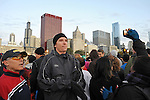 Denis Brogniart, French host of French reality television show Survivor, enters the start of the race with fellow French runners before the Chicago Marathon in Chicago, Illinois on October 11, 2009.