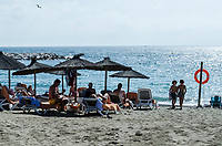 Spain, Puerto Banus, beach, playa, Marbella, Espana, bathers, sun worshippers, recliners, 201710154721<br /><br />Copyright Image from Victor Patterson, 54 Dorchester Park, Belfast, UK, BT9 6RJ<br /> <br /> t1: +44 28 9066 1296 (from Rep of Ireland 048 9066 1296)<br /> t2: +44 28 9002 2446 (from Rep of Ireland 048 9002 2446)<br /> m: +44 7802 353836<br /> <br /> victorpatterson@me.com<br /> www.victorpatterson.com<br /> <br /> Please see my Terms and Conditions of Use at victorpatterson.com . It is IMPORTANT that you familiarise yourself with them.<br /> <br /> Images used on the Internet incur an additional cost and must be visibly watermarked i.e. &copy;Victor Patterson within the body of the image and copyright metadata must not be deleted. Images used on the Internet have a size restriction of 4kbs and are chargeable at rates available at victorpatterson.com.<br /> <br /> This image is only available for the use of the download recipient i.e. television station, newspaper, magazine, book publisher, etc, and must not be passed on to any third party. It is also downloaded on condition that each and every usage is notified within 7 days to victorpatterson@me.com<br /> <br /> The right of Victor Patterson to be identified as the author is asserted in accordance with The Copyright Designs And Patents Act (1988). All moral rights are asserted.