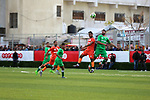Palestinian football players of Etihad Khan Younis (red) and Khadamat Rafah (green) compete during the final match in al-Quds premier league, at Khan Younis stadium, in the southern Gaza Strip on March 10, 2019. Photo by Wael al-Halabi