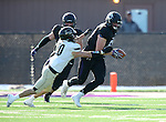 SIOUX FALLS, SD, NOVEMBER 26:  Evan Gentry #69 from the University of Sioux Falls is brought down by Eric Kelly #20 from Harding University after picking up a fumble Saturday afternoon at Bob Young Field in Sioux Falls. (Photo by Dave Eggen/Inertia)