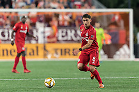 FOXBOROUGH, MA - AUGUST 31: Marco Delgado #8 of Toronto FC dribbles at midfield during a game between Toronto FC and New England Revolution at Gillette Stadium on August 31, 2019 in Foxborough, Massachusetts.