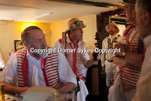 Morris men in Essex village pub. Decorated with union jack english Uk flags.