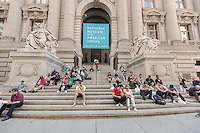 Tourists sit on the steps of the closed Smithsonian National Museum of the American Indian in Bowling Green in New York on Tuesday, October 1, 2013. A partial government shutdown took effect today because of a dispute between Democrats and Republicans in Congress over the Obamacare program. Approximately 800,000 federal workers have been furloughed and only essential services are up and running.  © Richard B. Levine)