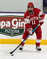 WORCESTER, MA - FEBRUARY 08: Mackenna Parker #11 of Boston University looks to pass during a game between Boston University and College of the Holy Cross at Hart Center Rink on February 08, 2020 in Worcester, Massachusetts.