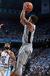 Mitchell Wilbekin (10) of the Wake Forest Demon Deacons attempts a jump shot during first half action against the North Carolina Tar Heels at the Dean Smith Center on December 30, 2017 in Chapel Hill, North Carolina.  The Tar Heels defeated the Demon Deacons 73-69.  (Brian Westerholt/Sports On Film)