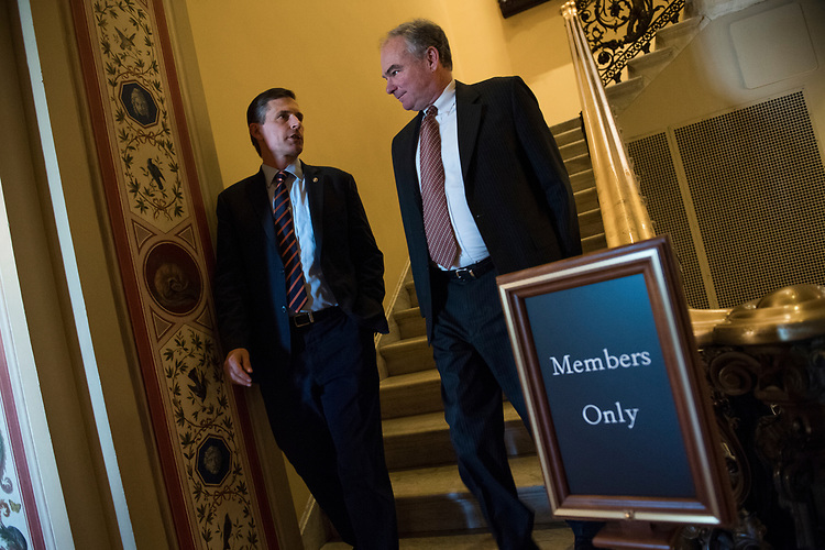 UNITED STATES - JULY 10: Sens. Tim Kaine, D-Va., right, and Martin Heinrich, D-N.M., are seen after the Senate Policy luncheons in the Capitol on July 10, 2018. (Photo By Tom Williams/CQ Roll Call)