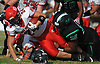 Nathan Sigerson #24 of Center Moriches, left, gets brought down after rushing for a gain in a Suffolk County Division IV varsity football game against host Wyandanch High School on Thursday, Sept. 7, 2017.