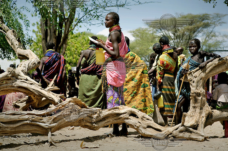 Turkana women gather at a food distribution point at a health post supported by Merlin NGO and USAID.