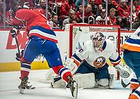 WASHINGTON, DC - JANUARY 31: Semyon Varlamov #40 of the New York Islanders  tracks Alex Ovechkin #8 of the Washington Capitals during a game between New York Islanders and Washington Capitals at Capital One Arena on January 31, 2020 in Washington, DC.