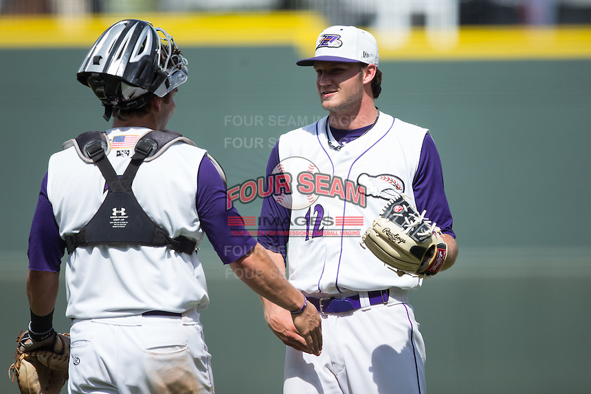Winston-Salem Dash starting pitcher Spencer Adams (12) is congratulated by his catcher Brett Austin (7) after his complete game shutout of the Wilmington Blue Rocks at BB&T Ballpark on June 5, 2016 in Winston-Salem, North Carolina.  The Dash defeated the Blue Rocks 4-0.  (Brian Westerholt/Four Seam Images)