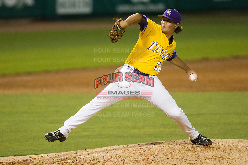 LSU Tigers pitcher Chris Cotton #58 delivers a pitch during the NCAA Super Regional baseball game against Stony Brook on June 10, 2012 at Alex Box Stadium in Baton Rouge, Louisiana. Stony Brook defeated LSU 7-2 to advance to the College World Series. (Andrew Woolley/Four Seam Images)