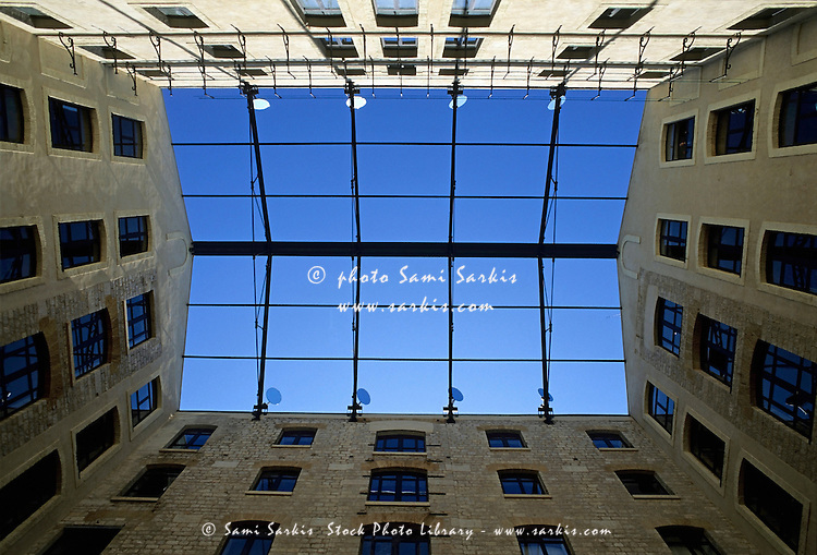 Blue sky as seen from a courtyard inside a building, Marseille, France.