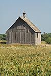 Wooden salt-box barn with rooftop ventilator, rural Nebraska